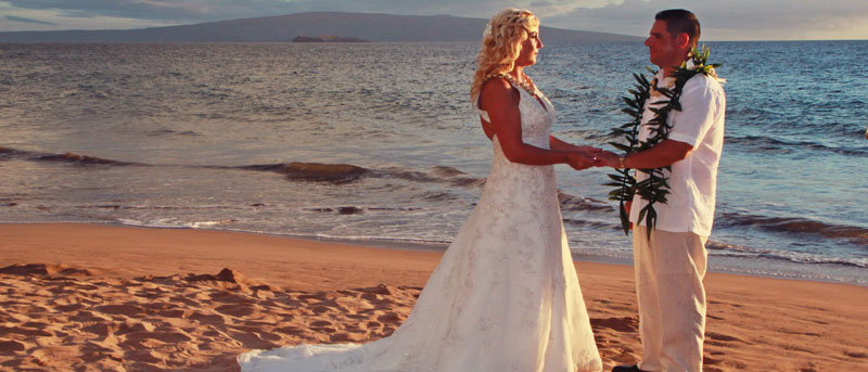 Maui Beach wedding at sunset with Kahoolawe and Molokini in the background.